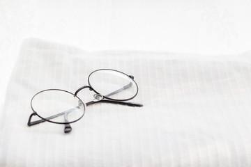 Glasses on white towel