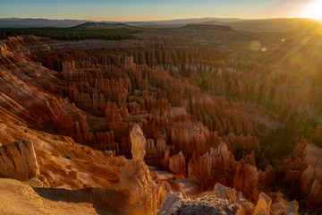 Sunrise with sunflare at Bryce Canyon National Park in the summer