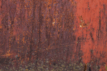 Rusty yellow-red textured metal surface. The texture of the metal sheet is prone to oxidation and corrosion. Textured Background in Grunge Style