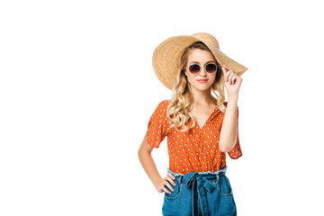 portrait of beautiful young woman in straw hat and sunglasses posing isolated on white
