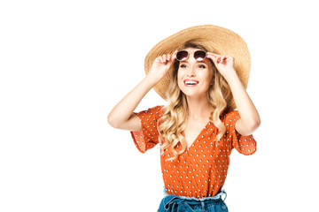 portrait of young cheerful woman in straw hat and sunglasses laughing isolated on white