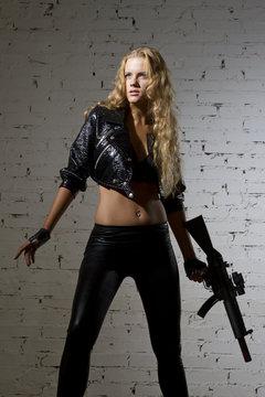 Woman with machien gun in studio