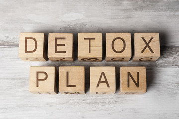 DETOX PLAN text on wooden cubes on wooden background