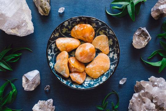 Orange Calcite and Quartz on Blue Table