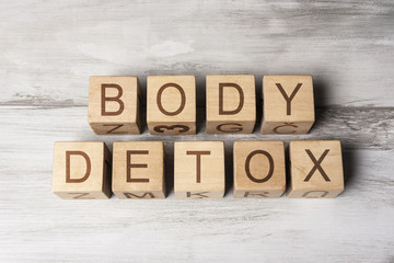 BODY DETOX text on wooden cubes on wooden background