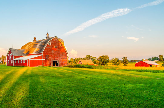 The Sun Begins To Set on a Farm in Minnesota