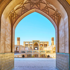 The Agha Bozorg mosque through the arch, Kashan, Iran