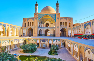 The arched niches in courtyard of Agha Bozorg Mosque, Kashan, Iran