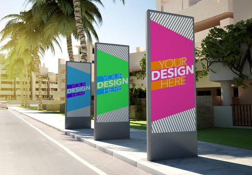 Three Advertising Kiosks on Sidewalk Mockup
