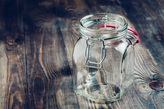 Empty glass jar on a wooden table - utensils for food