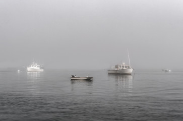 Moored Boats in Foggy Waters