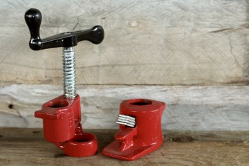 pipe cutter set close up on a natural wood background with writing space