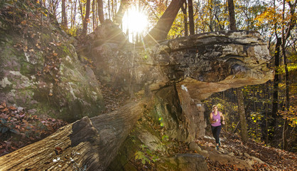 Woman trail running in forest, Moss Rock Preserve, Alabama, USA