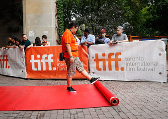 A volunteer rolls out the red carpet ahead of the Toronto International Film Festival (TIFF) in Toronto,