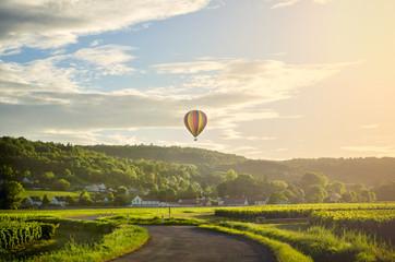 Poster Ballon Burgundy. Hot air balloon over the vineyards of the burgundy. France