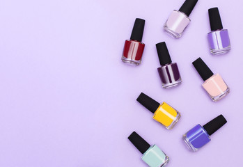 Nail work flat lay concept. Stylish trendy female manicure. top view of a set of jars with gel-varnish for nails of different trend colors and shades with space for text
