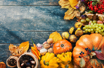 Happy Thanksgiving day concept - traditional holiday food with pumpkins on old wooden