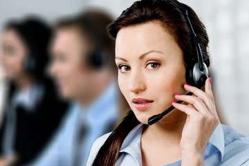 Close-up view of young woman face with headphones, call center
