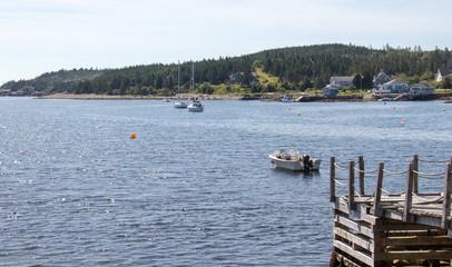 Boats in water, wide shot.