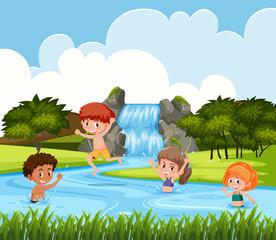 Children playing at waterfall