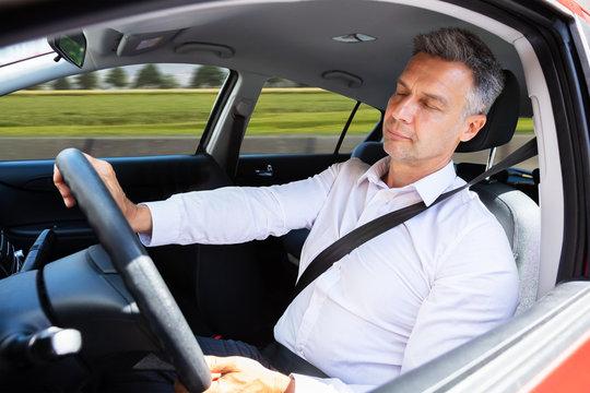 Man Sleeping While Driving Car