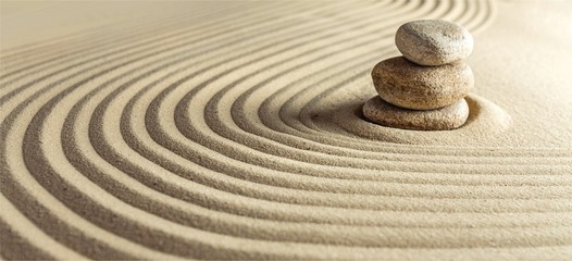 Poster Stones in Sand Japanese zen garden with stone in raked sand
