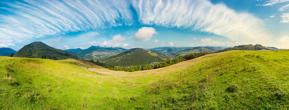 panorama of rural fields on curvy slopes. bright autumn day. lovely countryside on fine weather and gorgeous sky