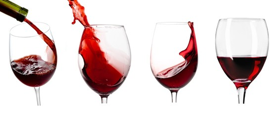 Pouring wine in glass on white background,