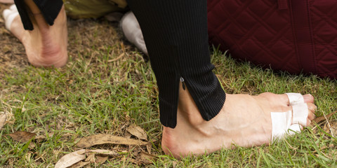 The feet of an elite athlete, a professional ballet dancer are taped to prevent injury.