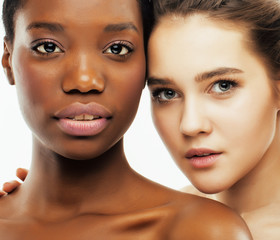 different nation woman: african-american, caucasian together iso