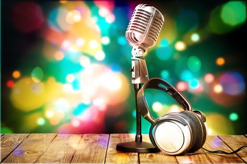 Retro style microphone on bokeh background