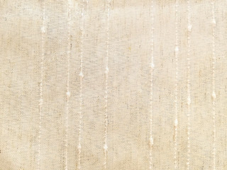 close up of cream colored linen fabric background