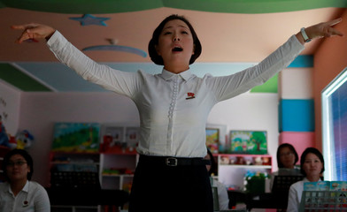 A student sings during a class at a teachers' training college during a government organised visit for foreign reporters ahead of the 70th anniversary of North Korea's foundation, in Pyongyang