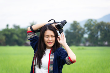 Traveler women taking photo with old fashioned camera. background the nature field rice .Happy tourist woman enjoy and relax serenity vacation. Lifestyle and Travel