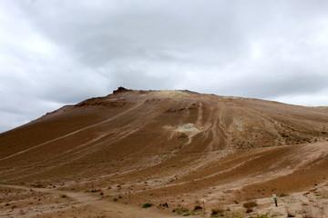 Krýsuvík Geothermic area in Iceland: brown soil, volcanic fumaroles