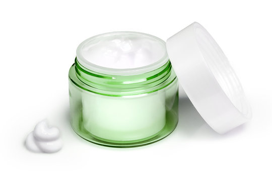 Container of moisturizing face cream on white background. Fashion woman still life. Pop female things, medicine and cosmetic theme.