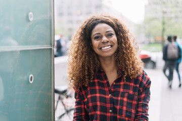 Street portrait of cheerful African American woman