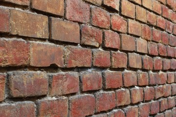 A retro red brick wall is a close-up