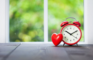 Clock and red heart