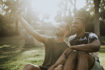 Gay couple taking a selfie in the summer