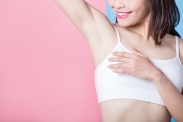 woman with armpit plucking