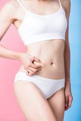 woman pinch her thin waist