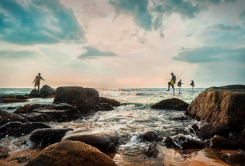 SRI LANKA, Traditional Sri Lanka sea fishermen, Tropical beach under blue sky in sunny day