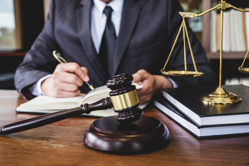 Legal law, advice and justice concept, Judge gavel with Justice lawyers, Counselor in suit or lawyer working on a documents in courtroom