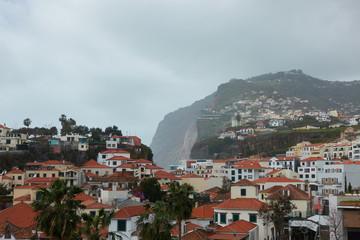 View of Câmara de Lobos in Madeira with Cape Girao on the background