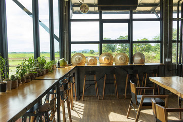 Small trees in pots placed on balcony wood in cafe