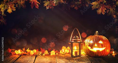 Halloween pumpkin with lantern on wooden