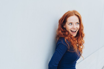 Young redhead woman with an excited expression