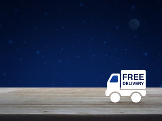 Free delivery truck flat icon on wooden table over fantasy night sky and moon, Business transportation concept