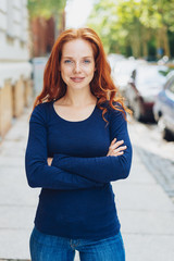 Confident slim young redhead woman